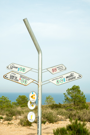 Hiking signpost giving directions on one of the many trails on Costa Blanca, Alicante, Spain Stock Photo