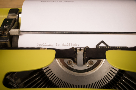 Old typewriter with text that contains spelling mistakes, a concept