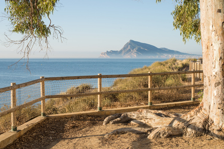 sierra: Early morning on the calm waters of Altea Bay, Costa Blanca, Spain Stock Photo