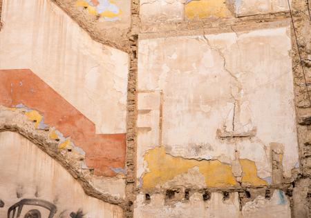 Old wall  of a ruined building displaying several colours and textures
