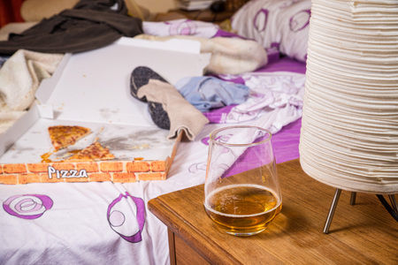 Unmade bed in a totally messy condition, a single lifestyle concept Reklamní fotografie