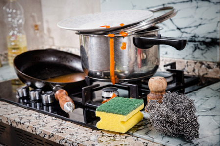 Messy kitchen with dirty cookware, a single lifestyle concept