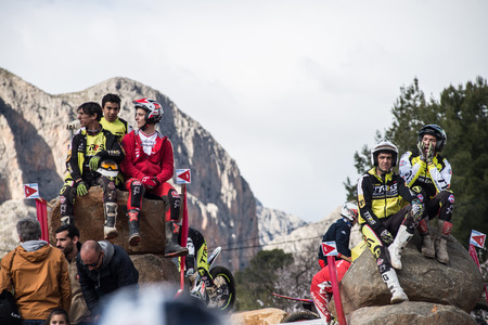 LA NUCIA, SPAIN - FEBRUARY 11th 2018:  Fans watching the action sitting on top of rocks during the Spanish National Trial Championship