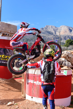 LA NUCIA, SPAIN - FEBRUARY 11th 2018: Unknown rider masters an obstacle at the Spanish National Trial Championship. Redactioneel
