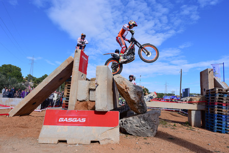 LA NUCIA, SPAIN - FEBRUARY 11th 2018: World Champion Toni Bou on a Honda bike jumps over an obstacle at the Spanish National Trial Championship. Redactioneel