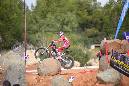 LA NUCIA, SPAIN - FEBRUARY 11th 2018: Jaime Busto on a GasGas bike jumps over an obstacle at the Spanish National Trial Championship. Editoriali