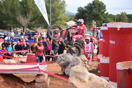 LA NUCIA, SPAIN - FEBRUARY 11th 2018: Jaime Busto on a GasGas bike jumps over an obstacle at the Spanish National Trial Championship.