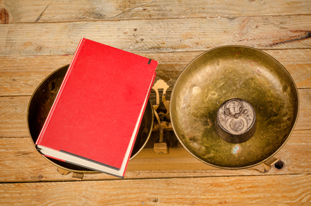 Vintage scales  displaying a concept on education Stock Photo