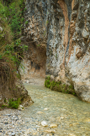 Steep rock walls and crystal clear water at Gritar river gorge, Nerja, Spain. Foto de archivo