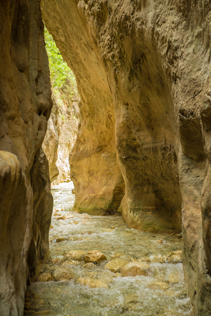 Steep rock walls and crystal clear water at Gritar river gorge, Nerja, Spain.