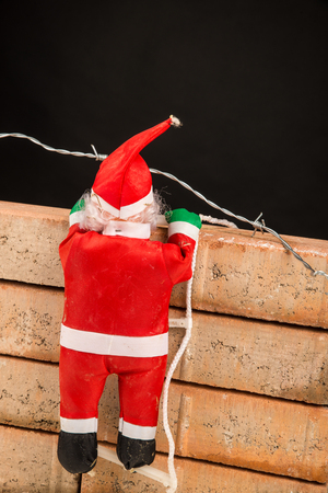 Santa trying to climb the wall, a concept on racism and anti immigration policies