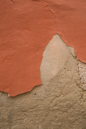 Old war with damaged plaster peeling off