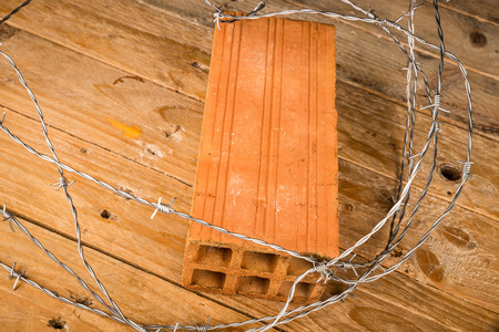 Brick and barbed wire, a concept on immigration policies