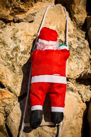 Santa climbing yet another wall Imagens