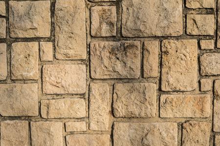 Full frame take of a weathered masonry wall