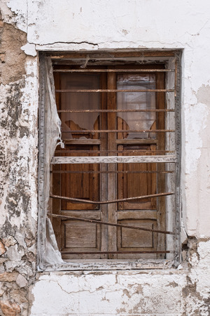 Detail take of an old peeling whitewashed facade