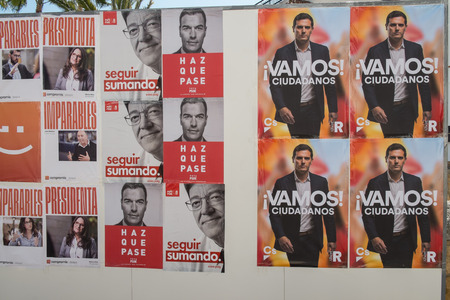 VALENCIA; SPAIN- April 11; 2019: Political campaign poster depicting several presidential candidates running for Spanish April elctions Редакционное