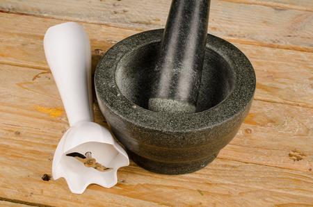Heavy stone mortar and pestle vs modern blender, an old vs new concept