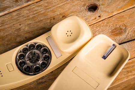 Old phone with its dial incorporated in the handset