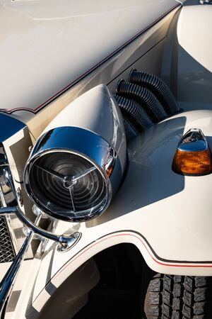 Detail take of classic car headlights