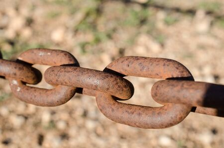 Rusty iron chain links, a concept on neglected security
