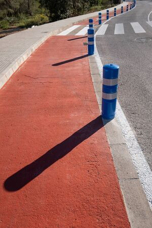 Bollards protecting a bicycle lane Imagens