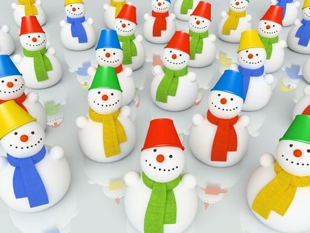 Colourful christmas snowmans in scarfs on skating rink photo