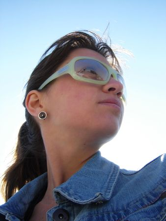 Portrait of the young woman on  blue sky                                photo