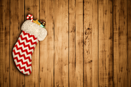 Christmas stocking on old wooden background 3 D rendering