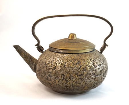 teakettle: Antique brass teapot collection, a longtime hobby of my mother. Stock Photo