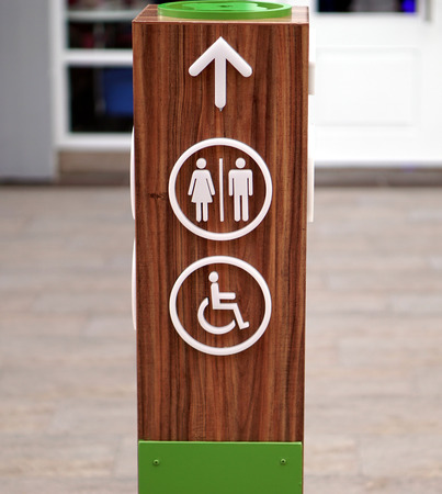 disabled access: Public restroom signs with a disabled access symbol