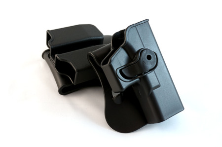 holster: Black holster on white background wasmade frm polymer.