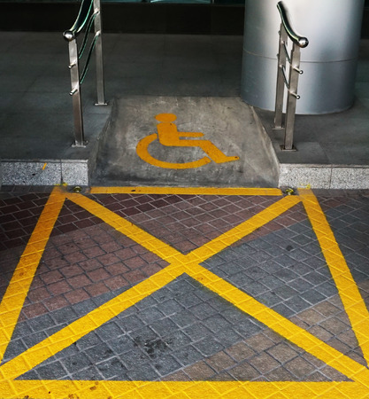 disabled parking sign: Outdoor disabled parking sign for past from handicap who use wheelchair.