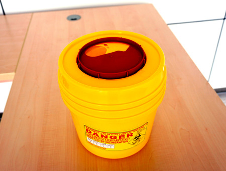 hazardous waste: hazardous container for radioactive waste on the table