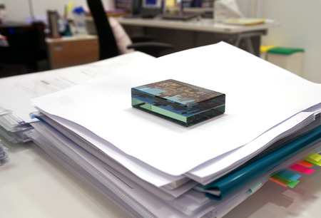 training device: The device is made of glass paperweights on documents in the training office.