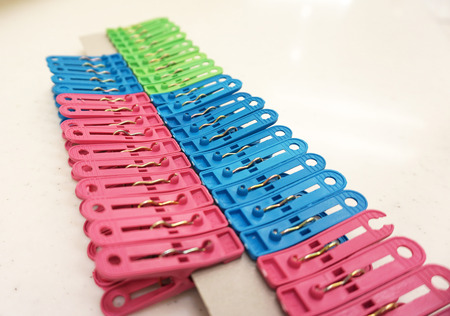 clench: Multicolor plastic clothespins isolated on the white background. Stock Photo