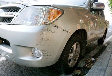fender bender: Black abrasions in front of a car caused by crash. Stock Photo
