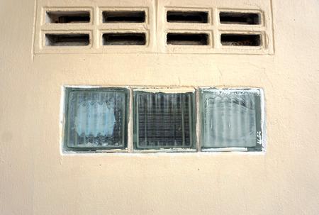 contaminated: Contaminated paint glass blocks  at wall of building