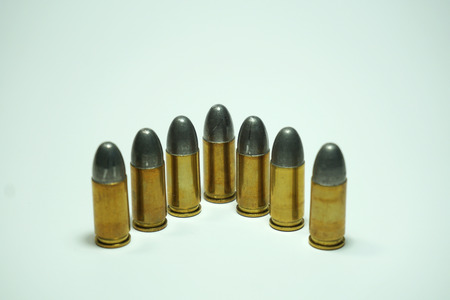 tazer: 9 mm Bullets were isolated on white background. Stock Photo