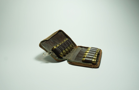 shootings: 11mm bullets and old bag isolated on white background Stock Photo
