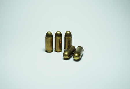 shootings: 11mm bullets isolated on the white background
