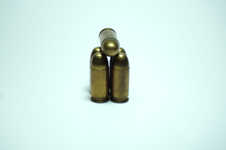 shootings: 11mm police bullets on white background