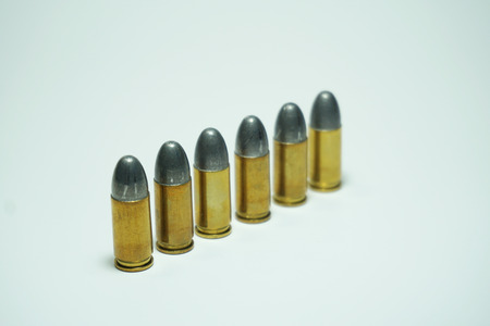 tazer: isolated 9mm bullets placed on white background