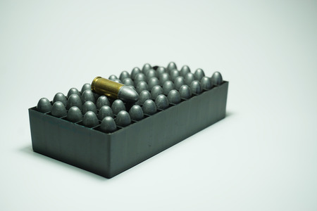 shootings: many 9mm bullets in box were isolated  on white background