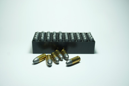 shootings: police bullets  9 mm and box on white background