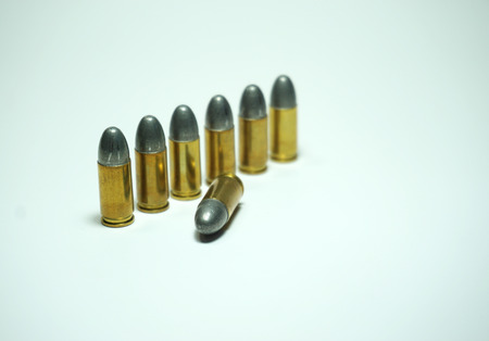 tazer: police bullets 9mm on white background Stock Photo