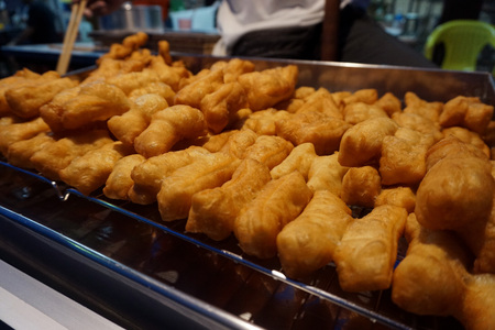 Chinese fried stick made for sell in the night market of Surat thani,the province of Thailand Stock Photo