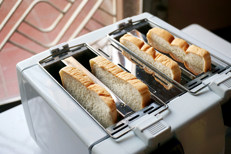 A slice of bread in the toaster