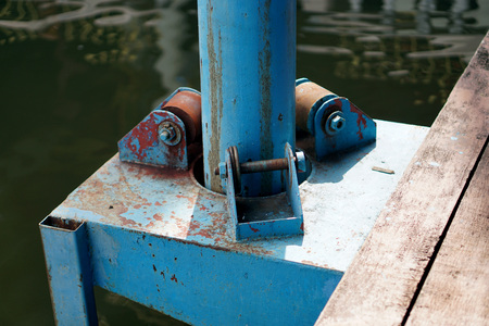 Floating Dock Pole. To help the boat dock is still afloat.                              Stock Photo