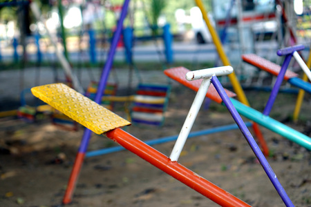 Seesaw or teeter-totter in playground                     Stock Photo